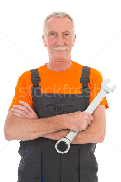 man in orange and gray overall with wrench Stock photo © ivonnewierink