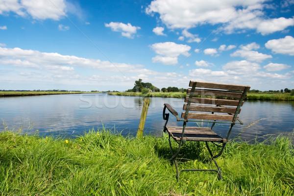 Nederlands rivier landschap stoel water bomen Stockfoto © ivonnewierink