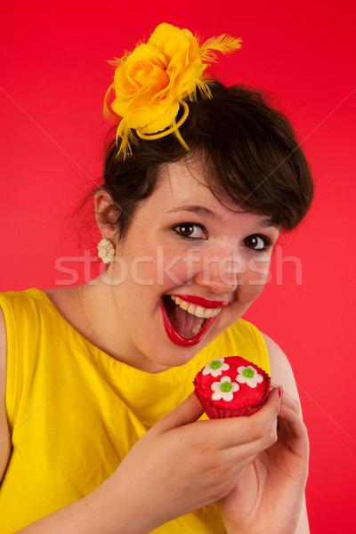 Stock photo: Woman eating cupcakes