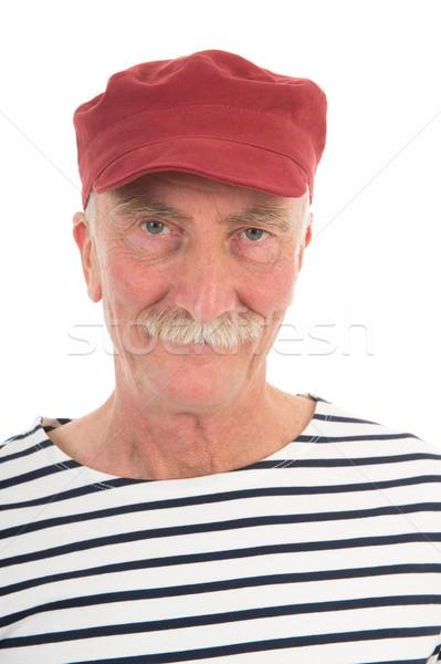 Portret emeryturę człowiek wąsy czerwony cap Zdjęcia stock © ivonnewierink