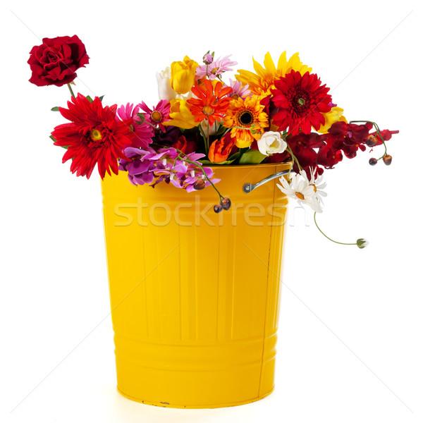 желтый мусорное ведро цветы полный шелковые оранжевый Сток-фото © ivonnewierink