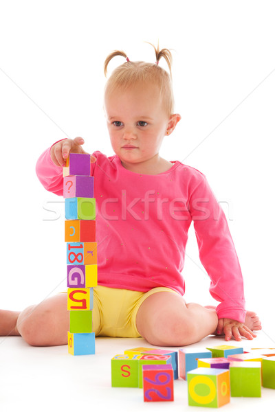 Toddler girl playing with blocks Stock photo © ivonnewierink