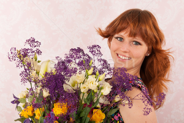 Woman with colorful flowers Stock photo © ivonnewierink