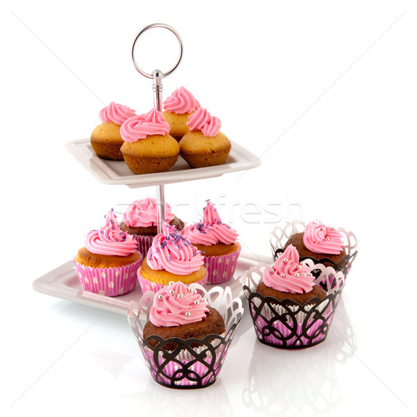 Stock photo: Many cupcakes at cake layer