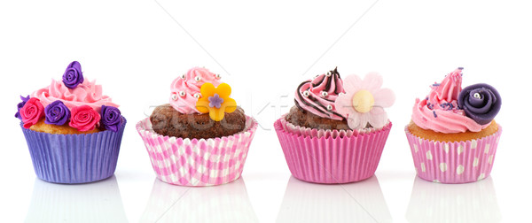 Csetepaté színes minitorták csokoládé rózsaszín vajkrém Stock fotó © ivonnewierink