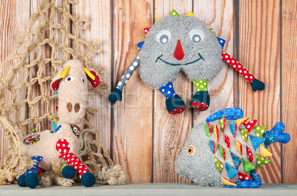 Stuffed funny toys on wooden background Stock photo © ivonnewierink