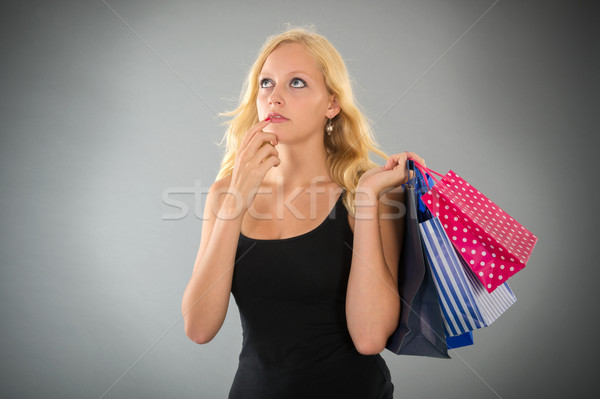 attractive blond woman with shopping bags forgot something Stock photo © ivonnewierink
