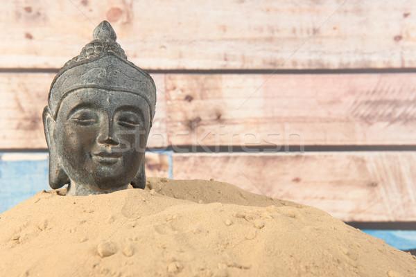 Buddha homok fából készült fa fekete fej Stock fotó © ivonnewierink