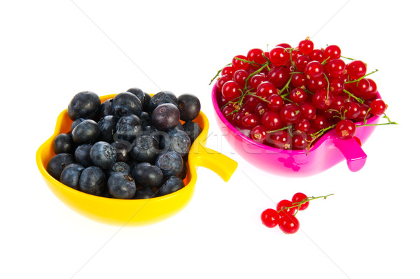 Blue berries and red currants Stock photo © ivonnewierink
