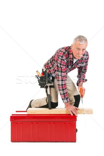 Senior manual worker sawing Stock photo © ivonnewierink