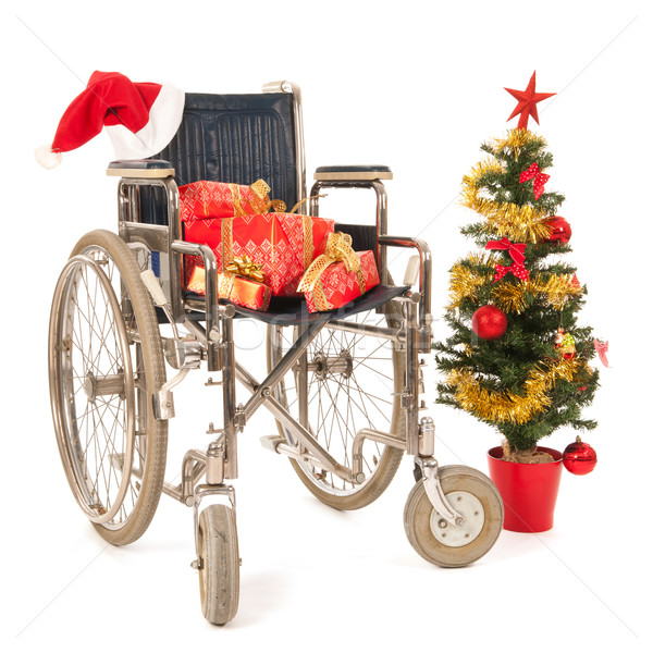 Empty wheelchair for Christmas party Stock photo © ivonnewierink