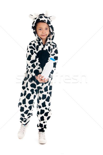 Little boy as cow with bottle of milk Stock photo © ivonnewierink