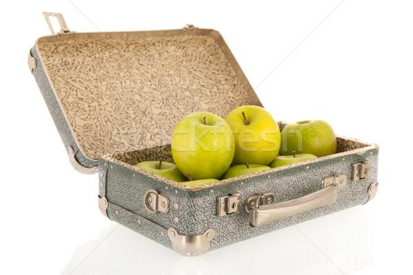 Open vintage suitcase with fruit Stock photo © ivonnewierink