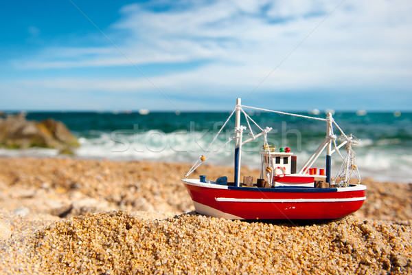 Fishing boat at the beach Stock photo © ivonnewierink