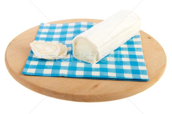 катиться Сыр из козьего молока синий салфетку бумаги фон Сток-фото © ivonnewierink