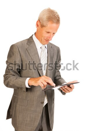 Senior business man with tablet Stock photo © ivonnewierink