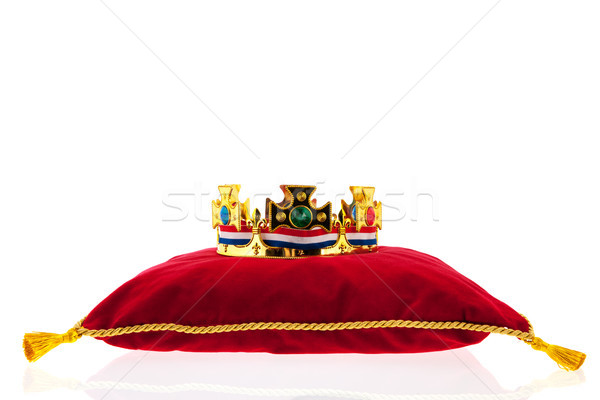 Golden crown on velvet pillow with Dutch flag Stock photo © ivonnewierink
