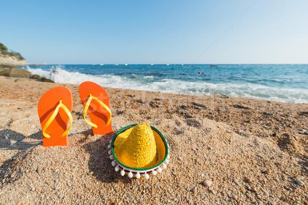 Flip flops at the Spanish beach Stock photo © ivonnewierink