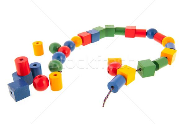 Foto stock: Brinquedo · de · madeira · cadeia · isolado · branco · azul · corda