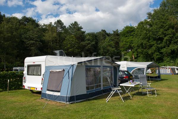 Stock photo: Caravan and shelter at the camping