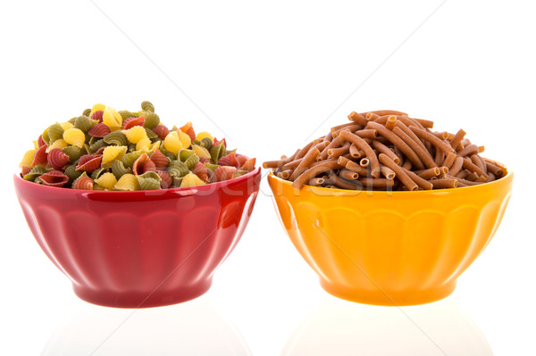 Wholemeal pasta in colorful bowls Stock photo © ivonnewierink