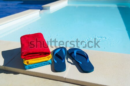Flip flops at swimming pool Stock photo © ivonnewierink