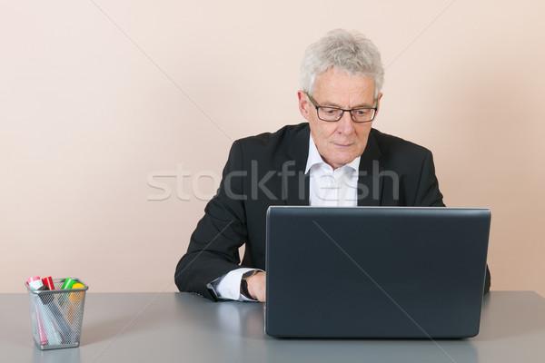 Senior man at the office Stock photo © ivonnewierink
