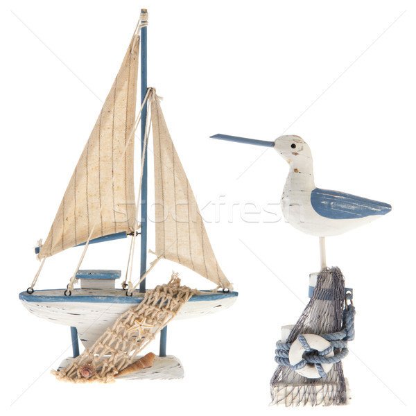 Old miniature sailboat and sea gull Stock photo © ivonnewierink
