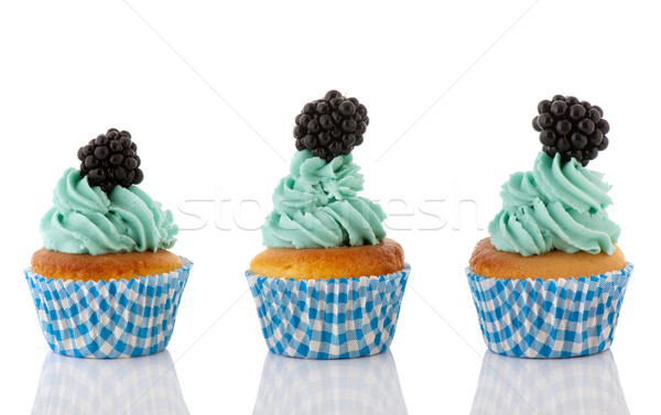 Cupcake in blue and green with fruit Stock photo © ivonnewierink