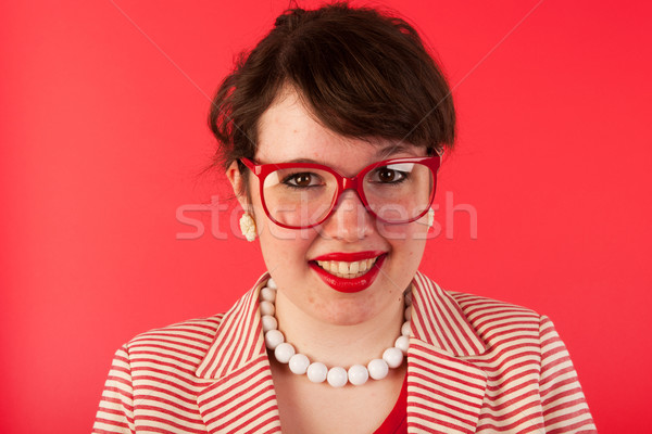 Young woman on red Stock photo © ivonnewierink
