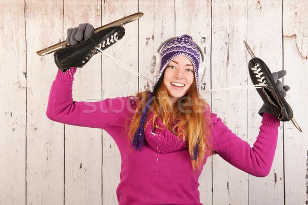 Kobieta zimą lodu łyżwy portret różowy Zdjęcia stock © ivonnewierink