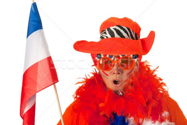 Dutch woman with flag as soccer fan Stock photo © ivonnewierink