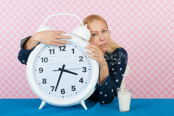 Woman with insomnia and big alarm clock Stock photo © ivonnewierink