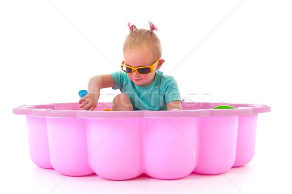 Stock photo: Toddler girl in swimming pool
