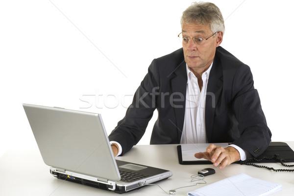 Spaventato manager senior spaventoso computer carta Foto d'archivio © ivonnewierink
