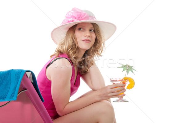 Kadın şezlong pembe kokteyl içmek cam Stok fotoğraf © ivonnewierink