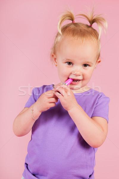 Zdjęcia stock: Dziewczyna · różowy · szminki · portret · gry