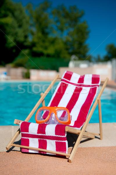 Leżak basen okulary ochronne ręcznik plaży wody Zdjęcia stock © ivonnewierink