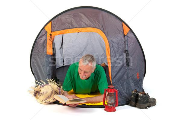 Starszy człowiek namiot wakacje czytania Zdjęcia stock © ivonnewierink