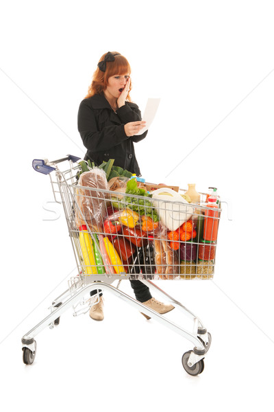 Woman with full shopping cart reading receipt Stock photo © ivonnewierink