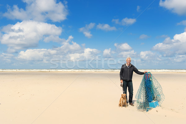 Man with dog at the beach Stock photo © ivonnewierink