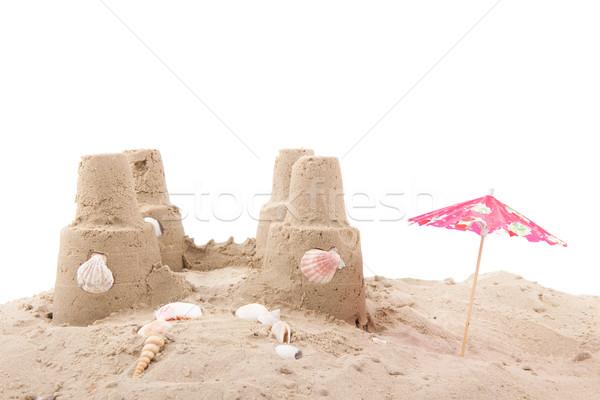 пляж двухуровневый стробирующий импульс снарядов зонтик белый фон Сток-фото © ivonnewierink