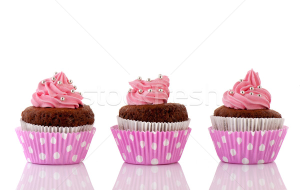 Three Chocolate cupcakes with pink butter icing Stock photo © ivonnewierink