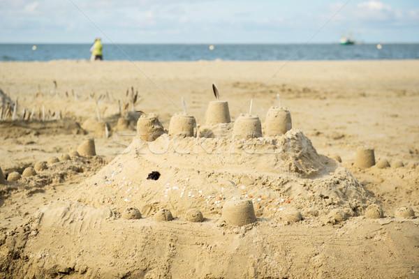 Homokvár tengerparti homok kastély gyerekek tengerpart tenger Stock fotó © ivonnewierink