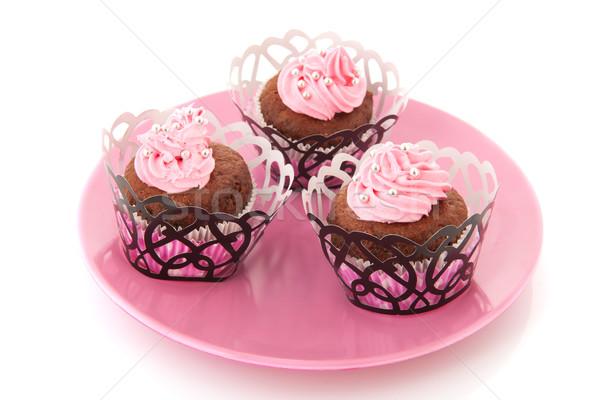 Csokoládé minitorták rózsaszín vajkrém cukorka gyöngyök Stock fotó © ivonnewierink