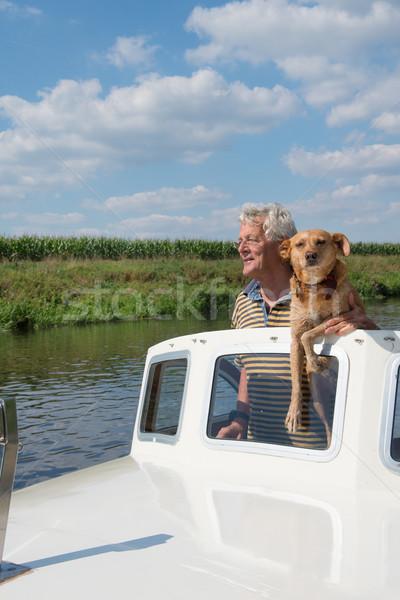 Férfi kutya csónak motorcsónak folyó nyár Stock fotó © ivonnewierink