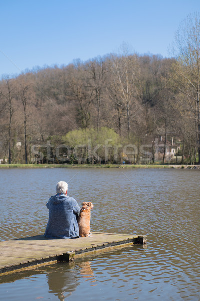 Man with dog on landing stage Stock photo © ivonnewierink