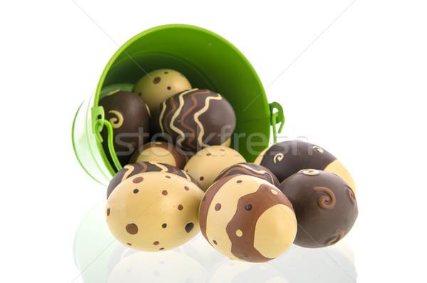 Chocolate eggs in green bucket Stock photo © ivonnewierink
