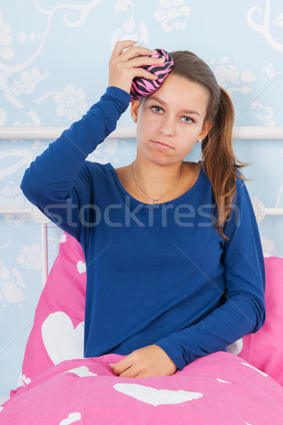 Teen girl with headache Stock photo © ivonnewierink