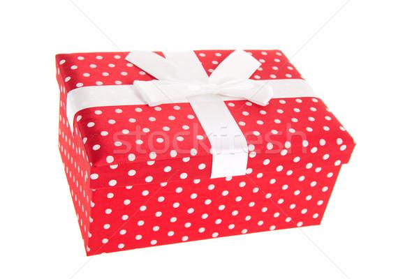 Kırmızı noktalı hediye sunmak şerit saten Stok fotoğraf © ivonnewierink